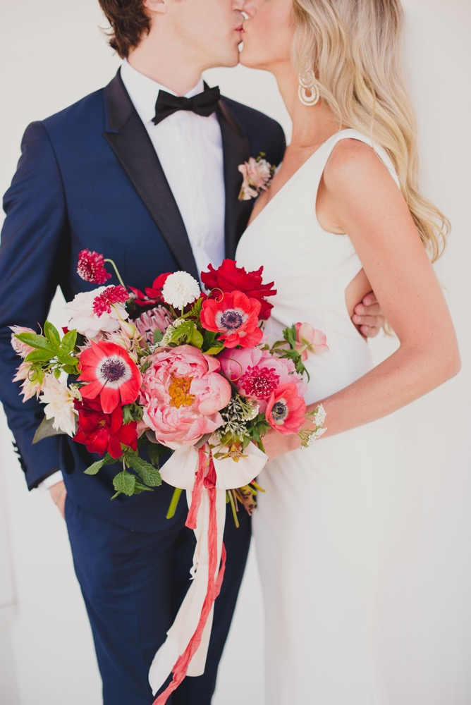 Red Bouquet at a colorful Madonna Inn Wedding designed by Pismo Beach Wedding Planners Sandcastle Celebrations