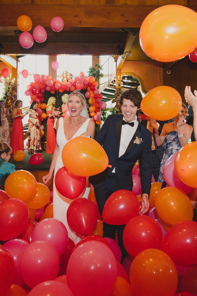 colorful ballon drop at a central coast wedding orchestrated by Pismo Beach Wedding Planners Sandcastle Celebrations