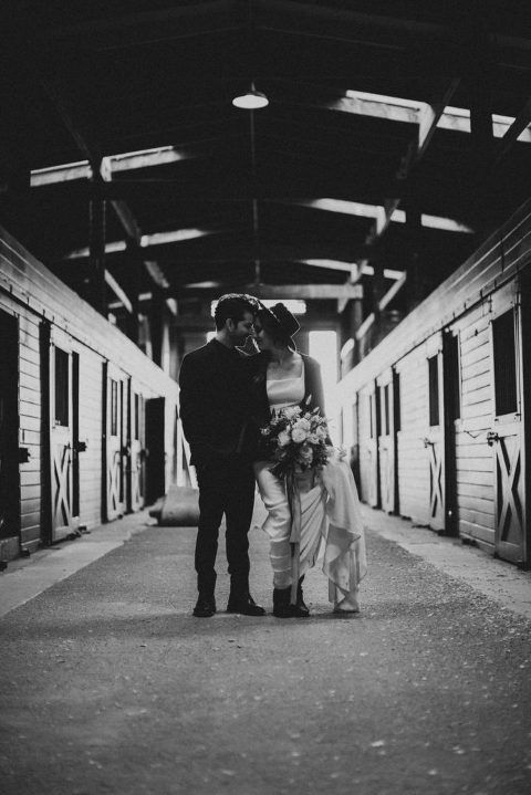Black and White Bride and Groom in San Luis Obispo Barn by wedding planner sandcastle celebrations